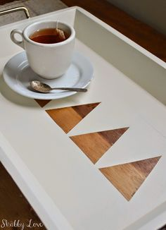 The cutest tray makeover by Shabby Love- I adore the wood triangles poking through the white paint.