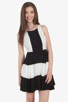 Black and white colorblock fit and flare dress with cutouts in the back. Invisible zipper closure on side. Fully lined. Pair it with black ankle boots and stacks of bracelets to complete the look. Women dress.