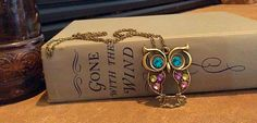 A personal favorite from my Etsy shop https://www.etsy.com/listing/201195866/blue-eyes-owl-charm-chain-necklace