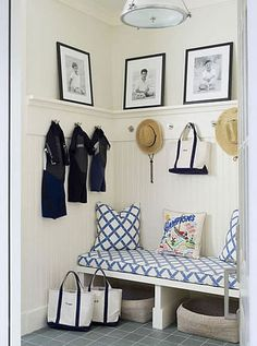 Mudroom/Foyer- Bench and ledges for photos, hooks for jackets, love!