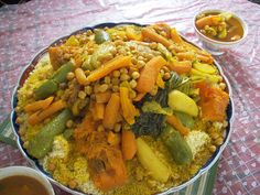 national dish of ALGERIA is couscous, garnished with vegetables and chichpeas Couscous Dishes, Vegetable Couscous, Vegetable Stew, Tunisian Food, Algerian Recipes, Middle Eastern Dishes, Legumes Recipe, National Dish, Morocco