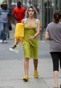 Yellow there! Stepping out in New York City on Thursday, Lourdes Leon maintained her quirk...