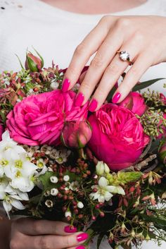 If you're all about the details, then your manicure will factor into that. You can't just wear any old pink or blush — it needs to perfectly complement your rings, skin tone, and, of course, the bouquet! Like this Hot Pink Punch