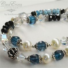 London Blue topaz, black spinel, Lotus pearls, sterling silver, and Swarovski crystals. My gorgeous new birthday bracelet!