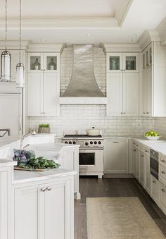 How great is this white kitchen - love the stainless vent hood