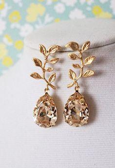 Light Silk Swarovski Crystal Teardrop (13mm x 18 mm) in Gold plated settings. Gold plated Leaf earrings. 925 sterling silver ear posts. Nickel Free.