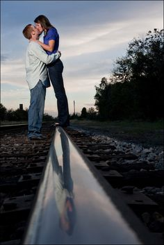 Love the reflection of the couple on the railroad.