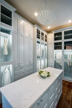 Painted closet with island and wardrobe cabinets