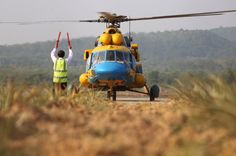 A helicopter lands after coming back from a search for the missing MH370 aircraft at Phu Quoc airport, on March 11, 2014. — Picture by Choo Choy May