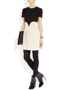 Victoria, Victoria Beckham dress, Wolford tights, Alaïa boots, Stella McCartney clutch, Eddie Borgo cuff