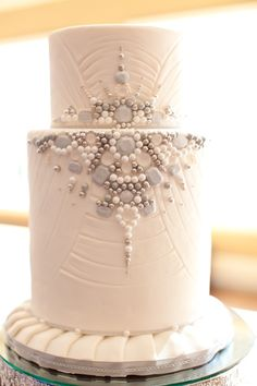 """wedding cake with edible gemstones - you could use """"emerald"""" gems and a bit of gold"""