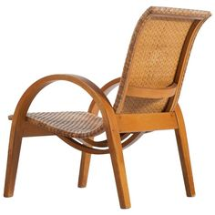 Elegant Wicker Easy Chair, France 1950s | From a unique collection of antique and modern lounge chairs at https://www.1stdibs.com/furniture/seating/lounge-chairs/