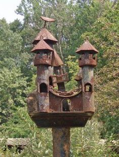 Castle-inspired birdhouse  Here's what to do with rusty old pipes and metal scraps. #fairygardening