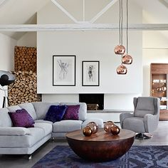 Add a statement look to your lounge with a cluster of copper ball pendant lights. Click to shop!