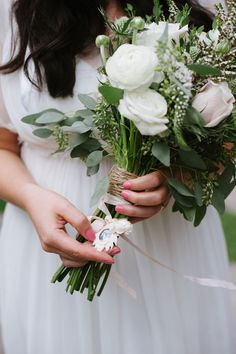Remember loved ones with a little memento on your bouquet. via Etsy Weddings Blog