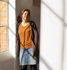 The Susanne Cardigan for teens/women by Compagnie M. is an open cardigan with big folded pockets.