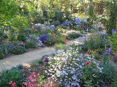 The site doesn't say what the path is made of; sure hope it's not just packed dirt. Michael Bates - English Country Garden Design, Inc