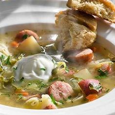 This hearty German cabbage soup recipe is made healthy with tons of leeks, cabbage, greens, carrot and celery. If you can't find smoked bratwurst or kielbasa, chicken sausage or ham makes a good substitute.