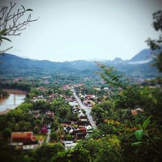On top of the world, victorious over 300+++ steps, viewing the UNESCO Heritage Site that is Luang Prabang, Laos.