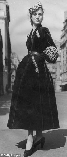 1947: In Paris a model wears another Christian Dior design