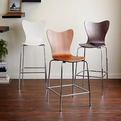 "Scoop-Back Bar Stool + Counter Stool Chocolate ($179) and walnut ($199) 26"" high West Elm"