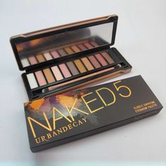 FAKE NAKED5 PALETTE. I can't believe how many repins per day this is getting! I thought it was pretty so I pinned it but once I saw the attention it was getting I looked into it, you can buy this fake online for under $10 but it's from China and sloppily made from reviews I've read and the pigmentation lacks compared to the real deal.