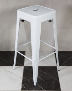 #DYK the perfect accessory for a classic kitchen is the Tolix bar stool. Designed in 1956 by French designer Pauchard, the chair was originally meant for factory workers in a local firm in France. By the 1970's the Tolix stool had become an icon of industrial design. We think it looks great with classic marble in a checkerboard pattern #trendingdesign #marblelook #tolixstool #trendyhome