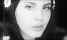 """Lana Del Rey  Love Video  Over the weekend Lana Del Rey came out with a mythic and gorgeous new reverb-pop single called """"Love."""" Today she's shared its video which is just as lovely in its own way. The clip starts out as pure '60s pastiche with LDR  in a white dress with flowers in her hair  singing the song to a gro..."""