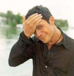 Alejandro Sanz - damn he looks like a young Mickey Rourke and Gabriel Macht rolled into one. Yummy.