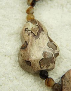 http://earthwhorls.com/collections/necklaces/products/1679sn  EarthWhorls listens to the stories stones tell! 20% off with code LOVEMOM for Mother's Day - free shipping!