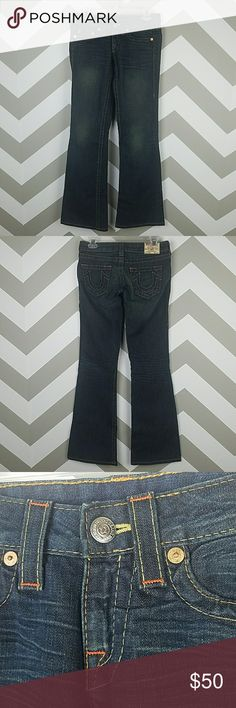 "True Religion dark denim bobby flared jeans sz 26 True Religion dark denim jeans in Bobby style.  Wide flare leg, signature stitching, logo pockets, and whiskering on front and back of knee.  Made in USA.  Size 26 excellent condition.  Total length (top of waist to hem) is 40""  inseam 33"" hips 36""  rise 6.25"" and leg opening 9.75"". True Religion Jeans Flare & Wide Leg"