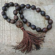 27 bead Japa mala for chanting on the go! Featuring deep chocolate Tulasi and lotus head bead with brow tassel.