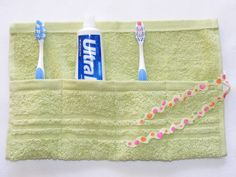 Terrycloth Toothbrush and Paste Travel Pouch in Spring Green. this is on etsy and no tutorial but you can easily eyeball this and just 'do it'.. great idea for packing toothpaste and tooth brushes for college kids going off to school or kids going off to summer camp!  or packing for vacation where ever you may be headed! Ric rac is used to tie it.