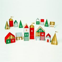 Wonderful 3D Christmas Advent calender paper boxes,1-24 days. Set includes buildings, trees and more to create a stylish and unusual Xmas setting.