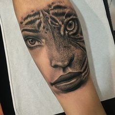Portrait & tiger fusion tattoo on girls arm by Samuel Rico, an artist based in Madrid.  http://tattooideas247.com/portrait-tiger-fusion/