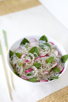A cold noodle salad with mint and radishes fresh from the garden in an Asian dressing, perfect for a side dish or easy lunch. From EatingRichly.,com