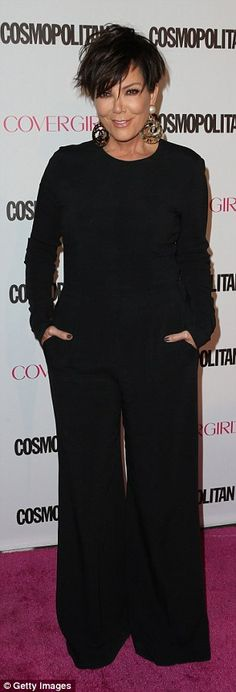 She's a cool mom: Kris Jenner teamed her slick one-piece with a mussed up hairdo...