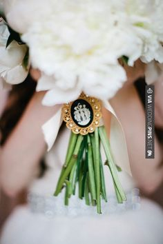 So neat - Lush white peony bouquet with white ribbon and black and white cameo brooch. Photo: Pam Cooley | CHECK OUT MORE GREAT BLACK AND WHITE WEDDING IDEAS AT WEDDINGPINS.NET | #weddings #wedding #blackandwhitewedding #blackandwhiteweddingphotos #events #forweddings #iloveweddings #blackandwhite #romance #vintage #blackwedding #planners #whitewedding #ceremonyphotos #weddingphotos #weddingpictures