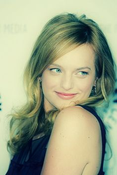 a very different look for Elisabeth Moss / Peggy Olson