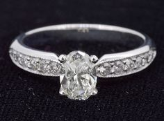 Ring (12) Round Diamonds .26ct.tw Center Oval Brilliant Diamond 2.02ct Clarity…