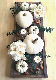 Contemporary Fall Centerpiece Idea with White Pumpkins - Modern Thanksgiving Table Decorations (thanksgiving decorations) Diy Thanksgiving Centerpieces, Fall Table Centerpieces, Thanksgiving Table Settings, Centerpiece Decorations, White Pumpkin Centerpieces, Holiday Decorations Thanksgiving, Harvest Table Decorations, Decorating For Thanksgiving, Fall Church Decorations