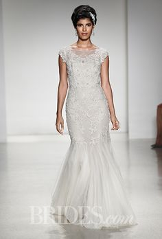 Brides: Alfred Angelo - Fall 2015. Style 897, re-embroidered lace and tulle trumpet wedding dress with sheer cap sleeves and an illusion bateau neckline, Alfred Angelo