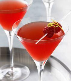 Raspberry Wisp     (1 1/2 parts Grey Goose Le Citron Flavored Vodka  1 1/2 parts fresh lemon juice  1/2 part simple syrup   3/4 parts Chambord raspberry liqueur   2 raspberries for garnish)