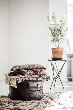 Moroccan Black leather puff. Textiles with a story. Marble Table Designed by Anniina Maukonen.