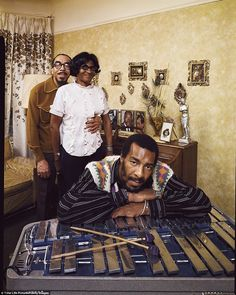 Folk singer Richie Havens leaning on xylophone with parents Richard and Mildred in their apartment in Brooklyn, New York. Tumblr