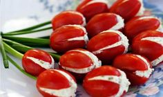 "Stuff small, cut & scooped tomatoes with cream cheese filling (i.e., chives and ham, pesto and Parmesan, etc.) to make tulips, garnish with green onion ""stems."" Good spring or Easter dish to pass."