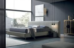 The minimalist lines and large volumes of this bed mean it really expresses the design concept. Made from curved metal, this unit that attaches to the edge of the bed serves as a practical bedside table, to keep everything to hand. Contract Furniture, Furniture Companies, Luxury Furniture, Furniture Design, Hotel Bedroom Design, Stay In Bed, Interiores Design, Modern Bedroom, Architecture