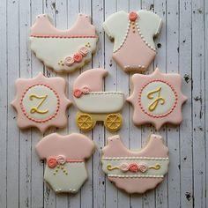 Pretty in pink........ #mycookiecrumbled #royalicingcookies #sugarcookies #babygirl #twingirls #twins #onesie #pram #monogram #roses #gold