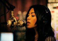Mariqueen Maandig of Trent Reznor's HDA putting in work on the mic.