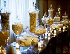 A glittering golden candy buffet, perfect for a Halloween Black & Gold Glam Gathering Party.